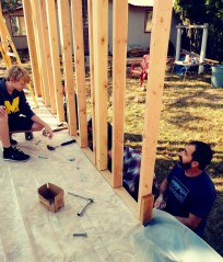 Mason and Matt securing a wall.